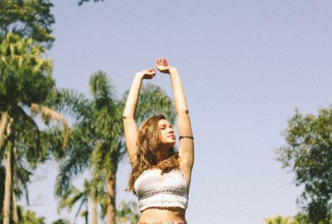 Woman Raising Arms showing Slim Summer Body